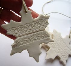 These simple but very pretty snowflake ornaments were handformed from bone china clay, antique lace pressed into the clay before bisc firing