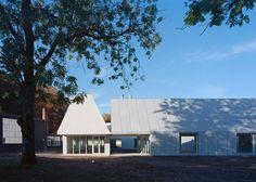 These art and design studios, featuring steeply pitched roofs and cement-panel cladding, have been added by New York studio MOS Architects to a college campus in Skive, Denmark.
