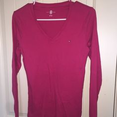 Tommy Hilfiger long sleeve top This is a slight used item, there is a small bluish stain in the back however it doesn't seem so noticeable, I did post a pic of it. Other than that it in really good condition. Tommy Hilfiger Tops Tees - Long Sleeve