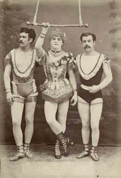 Three trapezists, one of them wearing women's clothes, 1880s