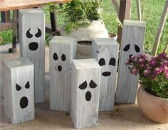 2x4 ghosts ~ white washed and painted eyes and noses