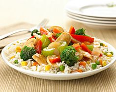 Simple Chicken Stir-Fry -   Heat1 tablespoon oil in a large nonstick skillet over MEDIUM-HIGH heat. Add chicken and cook until no longer pink, about 8 minutes: remove from skillet and set aside.  Add remaining 1 teaspoon oil and broccoli stir-fry to skillet. Cook, stirring frequently, until vegetables are tender.  Stir in stir-fry sauce and reserved chicken and continue cooking for an additional 2 minutes or until heated through.  Serve with prepared rice.