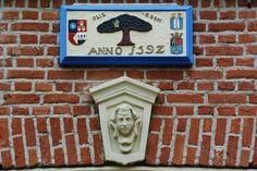Olieboom, gevelsteen, Amsterdam-sloten