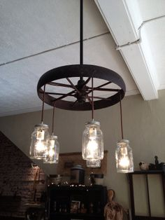 steel wagon wheel chandelier by gergenstudio on etsy 35000 alternating length wagon wheel mason jar