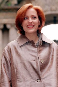 Best Red Hair Colors - 40 Iconic Redhead Celebrities - Elle - Anderson was born blonde, but switched to a rosy red color for her famous role as Scully on The X-Files