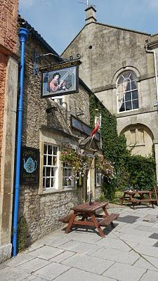 The Flemish Weaver pub in Corsham, Wiltshire, England, is named after a row of historic Flemish weaver's cottages nearby