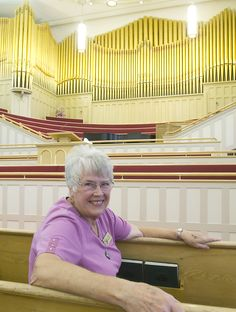 In this 2011 portrait, Lucille Hansen sits in the Logan LDS Tabernacle. Hansen's idea to use the Logan Tabernacle as a music venue more often turned into the Summer Noon Music Series, which is a series of free performances hosted at the Logan landmark. (Portrait by Eli Lucero)