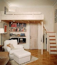 A loft bed with storage in the corner under the chairs, books right under it and a nice chair and what looks like a couch. Places I'd like to have in a smaller area