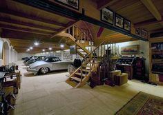 Garage for a collector of fine things - I think there must be the perfect Man Cave up those stairs. for a collector of fine things - I think there must be the perfect Man Cave up those stairs. Garage House, Garage Loft, Garage Workshop, Garage Shop, Man Cave Basement, Man Cave Garage, Car Man Cave, Men Cave, Garage Design