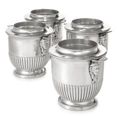 A SET OF FOUR SHEFFIELD-PLATED WINE COOLERS, CIRCA 1800 tub shaped on circular foot rim, with gadrooned lower bodies and loop handles springing from the heads of bacchic females, detachable collars and liners numbered 1-4 left of handles