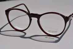 sweetmargot This is a NEW ( not worn) vintage eyeglasses frame with the demonstration lenses on.  It is small to medium in size.  The length of the frame