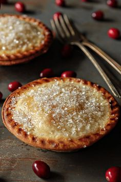Post image for Pear and Cranberry Individual Pies......Roasted Bosc pears blend perfectly with vanilla sugar and tart, fresh cranberries to create a deliciously festive dessert.