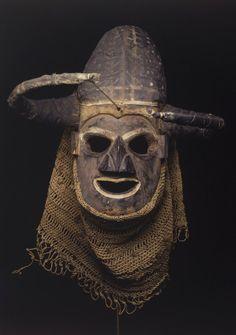 Africa | Anthropomorphic Mask. Culture: Yaka, Congo. Medium: Wood, cloth, raffia fiber, pigment, reed. Dates: early 20th century