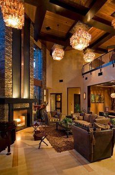 Fireplace waterfall by Earth and Water Studios. #lighting #mezzanine #CozyHome