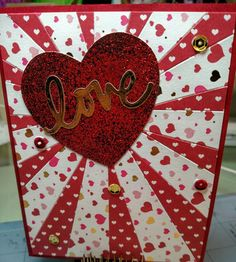 """Stampin up sunburst die.  Papers from Michaels, minc foiling on yellow bicycle """"love"""" die, minc glitter on die cut heart.  Sequins."""