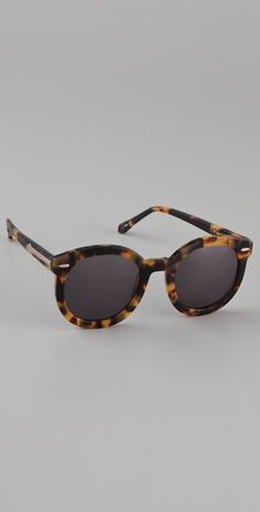 karen walker round sunnies...love these but I dont know if I can pull off a round frame