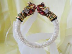 """Indian Jewelry- Bracelet- Minakari & bead Jewellery. White beads with minakari elephants bracelet bangle. """"Jai Ho"""" Ethnic Indian Bollywood bracelet. From Artikrti."""