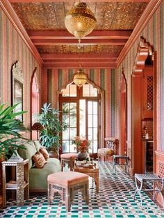 An exotic moment from a known authority on English and American decoration. The space dramatically comes together from an unerring sense for pattern, color, and light.
