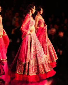 The Sartorial Pink The fuchsia pink 'Azalea' embroidered lehenga showcases the grand celebration of Indian culture and hand-done embroideries in all its admiration. The painterly richness of the multicolored floral thread work and bead work entwined with traditional zardozi beauty and Moroccan motifs running all through makes it a wardrobe of choice for a classic summer wedding. Thread Work, Zinnias, Wedding Outfits, Lehenga, Moroccan, Summer Wedding, Celebration, Bead, Culture