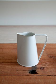 Ando Masanobu opening @ Mjölk Toronto  A ceramic pitcher inspired by antique enamelware.