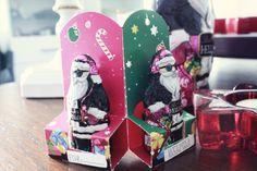HELLO XMAS HELLO MINI SANTAS, 50g Lindt HELLO Xmas Mini Santas ; Vollmilchschokolade ; Geschenkanhänger