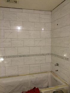Marissa Carrara tile from Home Depot with decorative pinwheel marble tile border, Tile with no grout