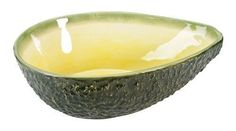 """Serve your favorite dinner in this Large Ceramic avocado bowl. Its a fun addition to your BBQ or just having a quite dinner with the family. Made from ceramic and measures 3.25""""H X 7.25""""W X 10.25""""L.We"""