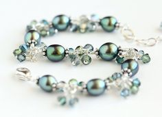 Sea Green Cluster Bracelet with freshwater pearls, Swarovski crystals, and sterling silver. By OpheliasJewels.