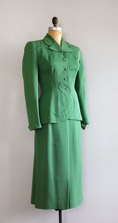 "Suit, Kay Sacks Original for Jacobson's: ca. 1940's, gabardine suit with ""French curve"" detail on jacket, fabric buttons, silk lining."