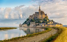 Morning View At The Mont Saint-Michel, France. Aside from the attractions in Paris, the Mont Saint Michel is the most visited tourist attraction in France. The massive edifice sits on its own island, and not only includes a castle, but an entire city. Mont Saint Michel France, Le Mont St Michel, Beautiful Castles, Beautiful Places, Romantic Places, Beautiful Pictures, Places To Travel, Places To See, Travel Around The World