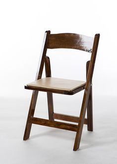 Folding chair with tan pad on seat.