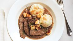 Sauerbraten with potato dumplings To cut nice, neat slices of roast, cook and refrigerate it the day before serving. Slice the roast cold, and reheat the slices in the sauce. Sauerkraut, Beef Recipes, Cooking Recipes, German Recipes, Amish Recipes, Hamburger Recipes, Yummy Recipes, Potato Dumpling Recipe, Chicken And Dumplings