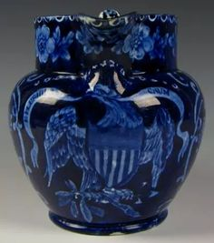 "Circa 1825 dark blue transfer pitcher by William Adams and Sons depicting an Eagle with shield and a banner in his beak with ""E Pluribus Unum"".  A nice example with no restoration and only a little glaze wear on the rim [and handle and] includes a couple ... shallow nicks. And there is some glaze scratching to the body seen in glancing light. A nice honest jug.  Measures 6&1/2"" to the rim.  Offered May, 2015 on ebay for $1,650."