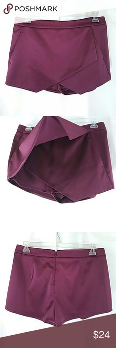 Express women's dress shorts front skirt 10 Beautiful burgundy silky dress shorts with back zipper and front skirt like detail. New without tags. Clean, never worn. Size 10. Express Shorts Skorts