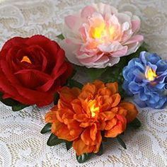 Flameless Tealight Flowers These colorful flowers are pretty in the daylight, but they're at their best when the lights are low. Scatter them on reception tables, buffet tables, or across a windowsill for a romantic glow. Led Tealight Candles, Tea Light Candles, Fake Flowers, Colorful Flowers, Plastic Flowers, Artificial Flowers, Fabric Flowers, Diy Floral Mirror, Battery Operated Tea Lights