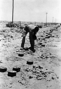 German sapper with mines on a british mine field near Marsa Matruh during the battle of El Alamein near the Egyptian border.