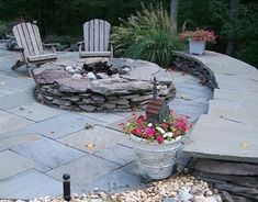 Fire pit idea.  I really like this one with the tile around it and the wall where people can sit.