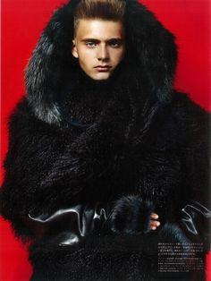 Male model wearing a black fur coat