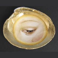 """Other endearments preceding hairwork included the """"lovers eye"""" jewelry. This piece is modern made by artist Tabitha Vevers."""