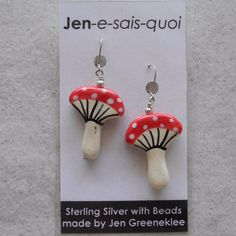 Earrings made with handmade ceramic beads with Sterling silver safety hooks