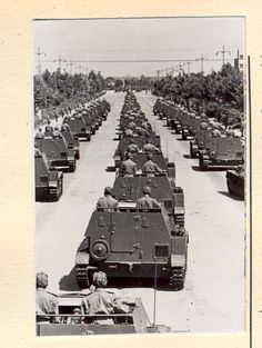 SU-76 self-propelled guns of the Romanian People's Army rolling past the General Military Academy in Bucharest at the 1950 Romanian Liberation Day Parade.