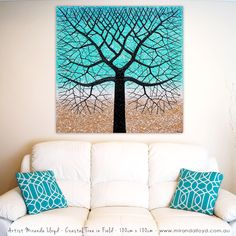 Coastal Tree in Field - 100cm x 100cm. Inspired by my love of the ocean and nature. The tree contrasts nicely on the beachy gradient background. The tree trunk has its own textures on top of the textural background of golds to beach blues.