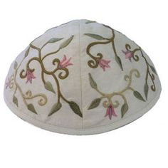 This soft, elegant kippa is a beautiful way to express your Judaism as well as your style. This beautiful white kippa is machine embroidered and features an elegant floral design.It would be a wonderful present for a Bar or Bat Mitzvah, birthdays, or for any Jewish Holiday.A personal inscription may be added to the kippas when buying in bulk for guests present at your Simcha. Embroidered Kippah - Flowers White of $14.00 only. For more info visit http://yarmulkes.com/system/scripts