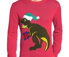 Santasaurus Rex Ugly Sweater - All his friends might be dead, but still happy to deliver a whole mess of tacky is this Santasaurus Rex Ugly Sweater. This 100% cotton piece of high fashion is perfect for your office holiday party since no one can resist the loving toothy grin of one of the most feared reptiles that ever lived hand delivering presents for all the good boys and girls. The Santasaurus Rex Ugly Sweater comes in Small, Medium, Large, X-Large, and XX-Large. #uglysweater