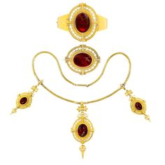 Fine Mid-Victorian Enamel Garnet Yellow Gold Suite | From a unique collection of vintage drop necklaces at https://www.1stdibs.com/jewelry/necklaces/drop-necklaces/