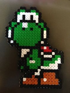 Yoshi (Mario) en perles à repasser Yoshi, Mario Bros, Perler Bead Art, Pearler Beads, Bead Weaving, Projects For Kids, Pixel Art, Diy And Crafts, Super Mario