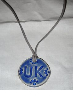 Handmade clay pendant on suede cord with lobster claw closure...any color or initials $12.00