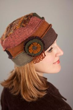 A hat made from upcycled sweaters! Love this hat... Now this is a cap that just might look good on me!                                                                                                                                                     More