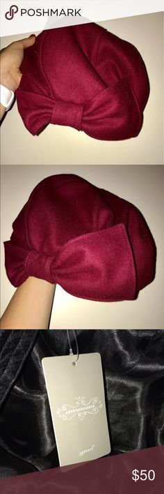 NWT - Anthropologie Bow Bucket Hat NWT!!!  Anthropologie Bow Bucket hat.  Great for the fall weather coming up!  Very warm, never worn!  Beautiful Maroon color. Anthropologie Accessories Hats