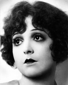 This is a photo of Madge Bellamy. Madge's cupid bow lipstick was popular in the 20's. The shape the lipstick made resembled Cupid's bow. Her dark eye makeup is character to the 20's when the Egyptian revival occurred.